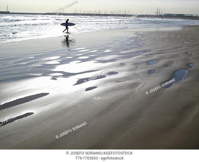 Beach with surfer
