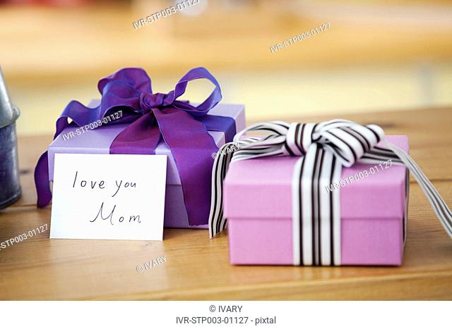 Two Wrapped Gift Box With Card