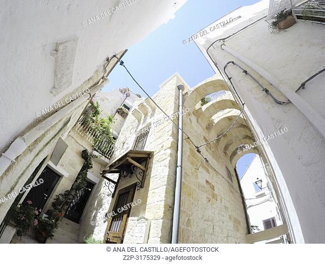 Narrow street at Polignano al Mare in Puglia Italy on July 12, 2018