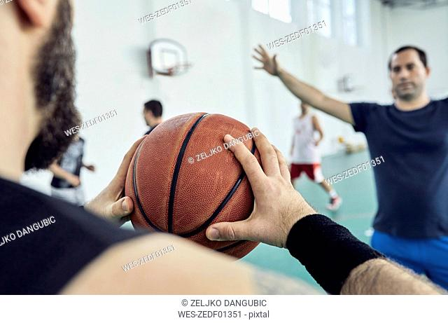 Man with basketball, indoor