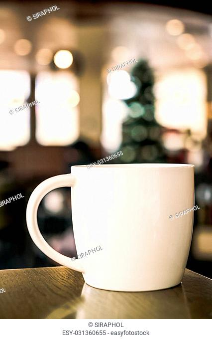 White Coffee cup in coffee shop interior background - vintage filter effect