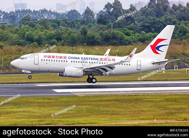 A China Eastern Airlines Boeing 737-700 aircraft with registration number B-6142 at Chengdu Airport, China, Asia