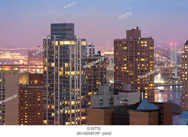 Cityscape and Triborough bridge at dusk, New York City, USA