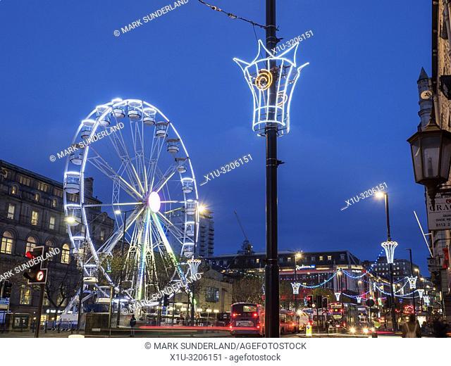Leeds Wheel of Light illuminated at dusk at Christmas on The Headrow in Leeds West Yorkshire England