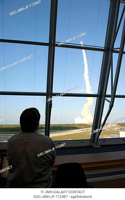 In Firing Room 4 of the Launch Control Center at NASA's Kennedy Space Center in Florida, Shuttle Launch Director Mike Leinbach watches space shuttle Discovery...