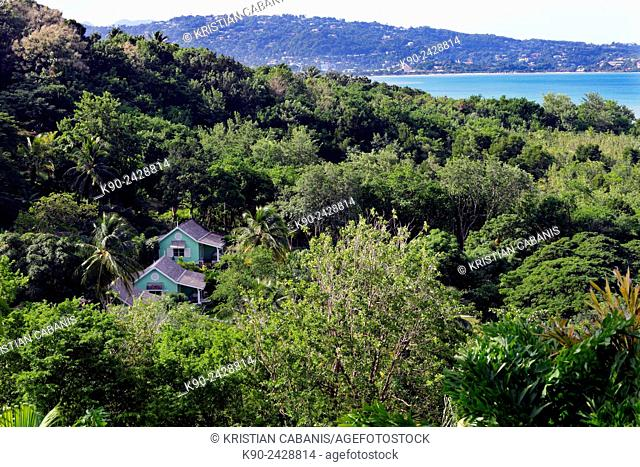 Small wooden house in the middle of the jungle with La Tuc Bay and Castries in the background, St Lucia, Windward Islands, Lesser Antilles
