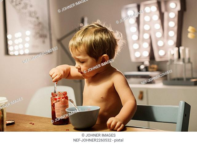 Boy eating jam