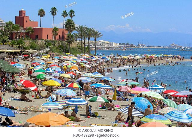 Beach and Bil-Bil castle at background, Benalmadena. Malaga province, Costa del Sol, Andalucia, Spain