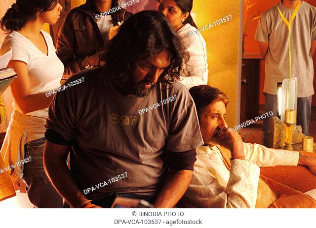 Director Rakesh Mehra shooting South Asian Indian Bollywood film star  Amitabh Bachchan for ad film in Mehboob studio ; Bombay Mumbai ; Maharashtra ; India