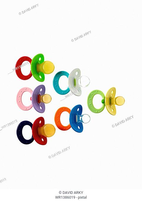 Coloured plastic baby pacifiers, dummies or soothers