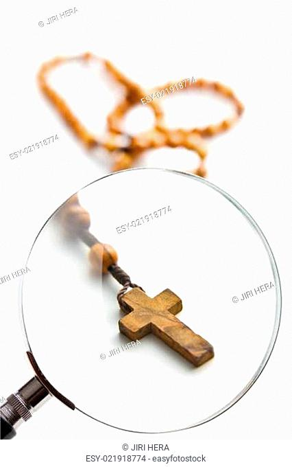 rosary beads under magnifying glass
