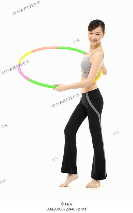 Woman stretching with hoop
