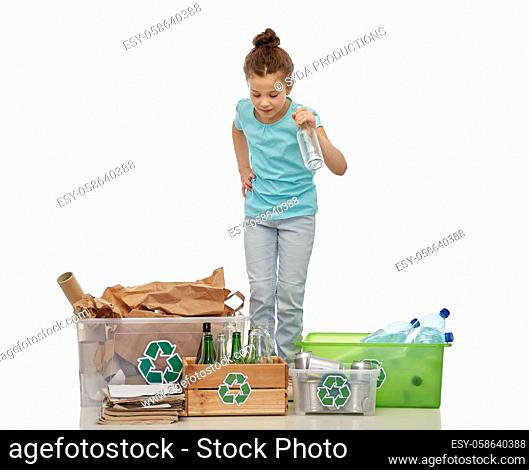 happy girl sorting paper, metal and plastic waste