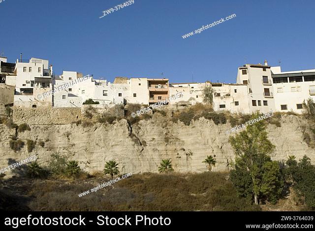 Picturesque houses over a gypsum cliff, Yesos de Sorbas, province of Almeria, Andalucia, Spain