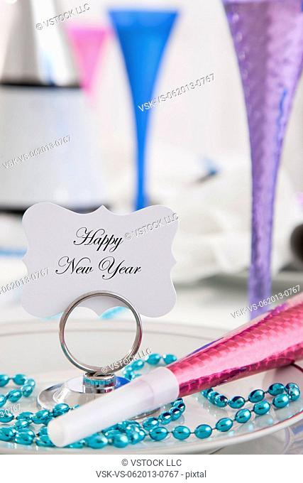 Place setting with card 'Happy New Year'