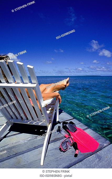Woman relaxes on dock