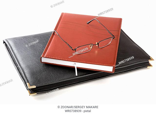 Folder for papers an organizer and glasses