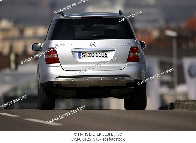 Mercedes ML 420 CDI, model year 2005-, silver, driving, diagonal from the back, rear view, country road
