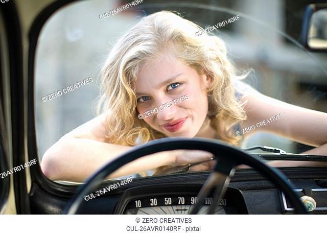 Girl up on a car