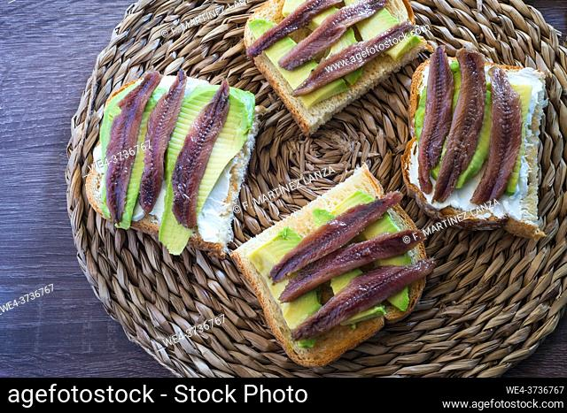 Toast with avocado and anchovy spread