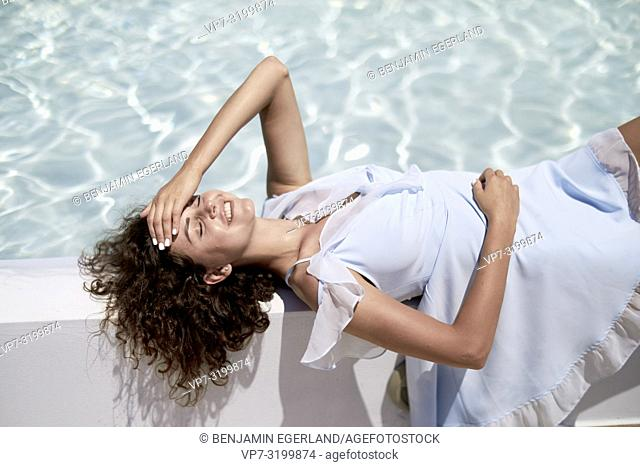 woman, relaxing, pool, holiday, summer, laying, chilling, recreation, relaxation, getting away from it all, resting, escaping daily life, vacations