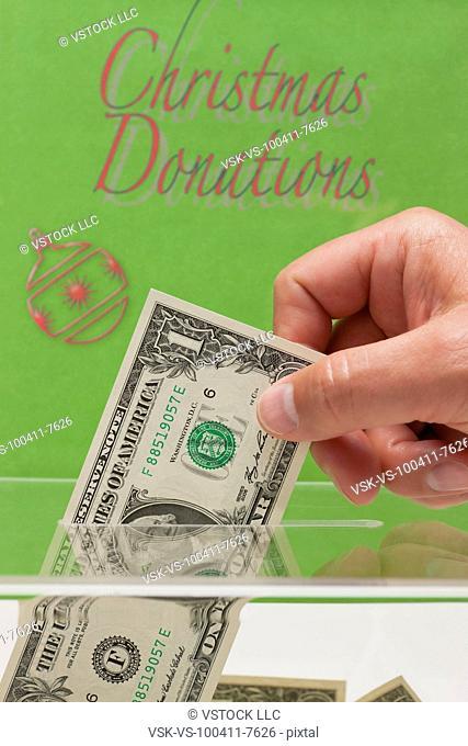 USA, Illinois, Metamora, Man's hand giving donation