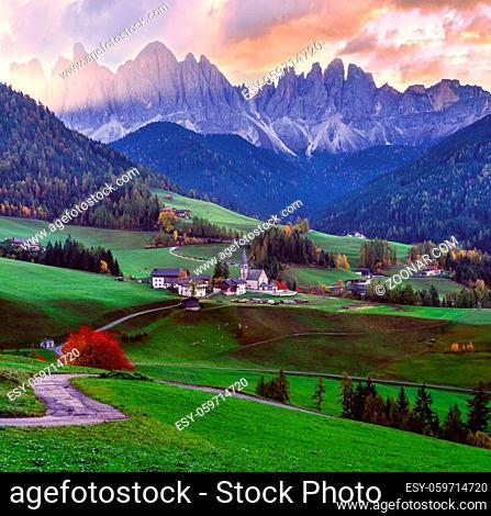 Autumn daybreak Santa Magdalena famous Italy Dolomites village view in front of the Geisler or Odle Dolomites Group mountain rocks