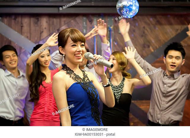 Friends celebrating and singing together
