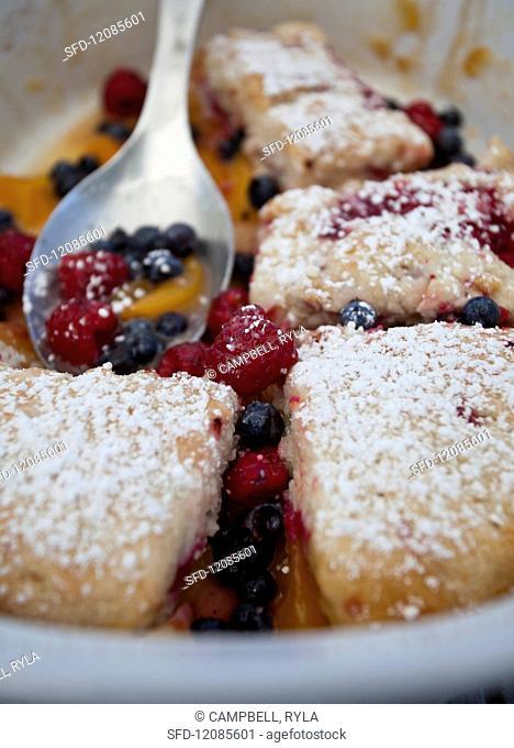 Peach, raspberry and blueberry cobbler