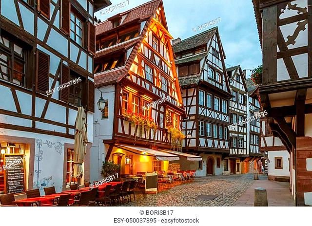 Street with historical half-timbered houses in Petite France district in Strasbourg, France. Evening