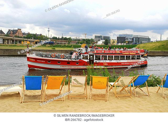Sand beach and trip ship at the Spree before the new main station Berlin Germany