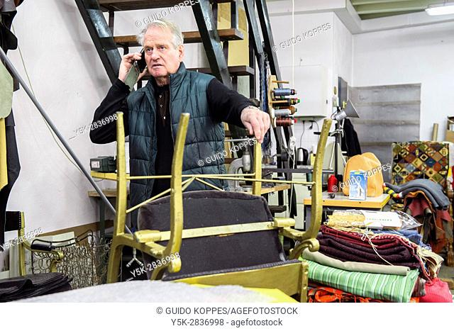 Tilburg, Netherlands. The 75 year old upholsterer Boy making his last phonecalls before partially retiring and moving his business homebound