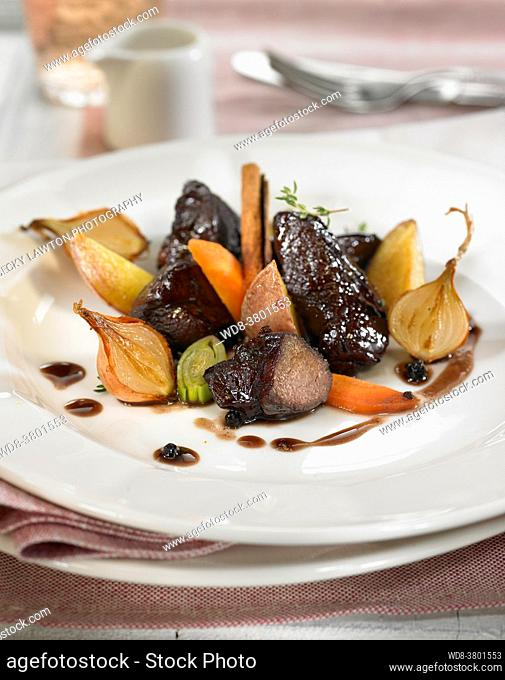 wild boar stew with red wine, carrots, onion and leeks