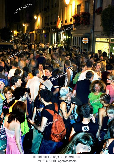 Paris, France, Crowd Scene in The Marais, French Gay & lebian Neighborhood, Sharing Drinks on Street at Night After Annual Gay Pride March