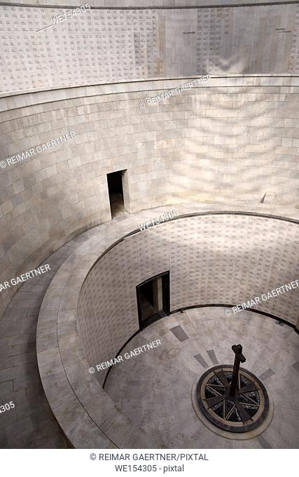 Central tower cross and circular levels of names of the interred at the World War I memorial at Oslavia Italy
