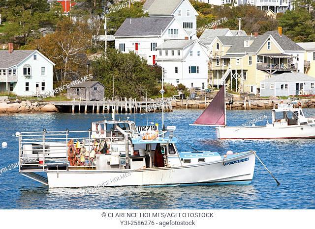 Lobster boats sit at anchor in Stonington Harbor in Stonington, Maine
