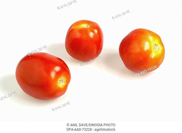 Vegetable , Three red uncut vegetable Tomatoes