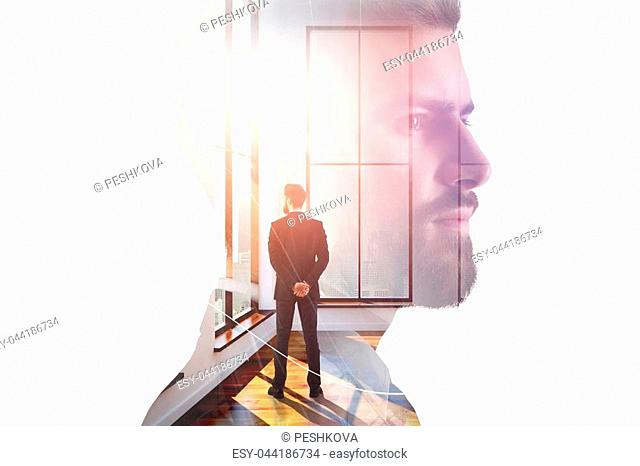 Businessman looking out of window in abstract interior with sunlight and colleague. Lifestyle and employment concept. Double exposure
