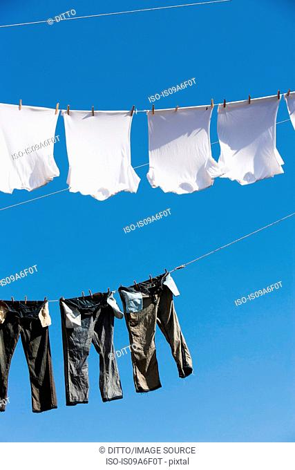 T shirts and trousers on clothes line
