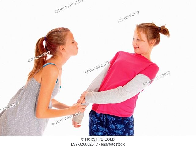 A young girl tried to give her sister a kiss but she dose not like it, .isolated for white background.