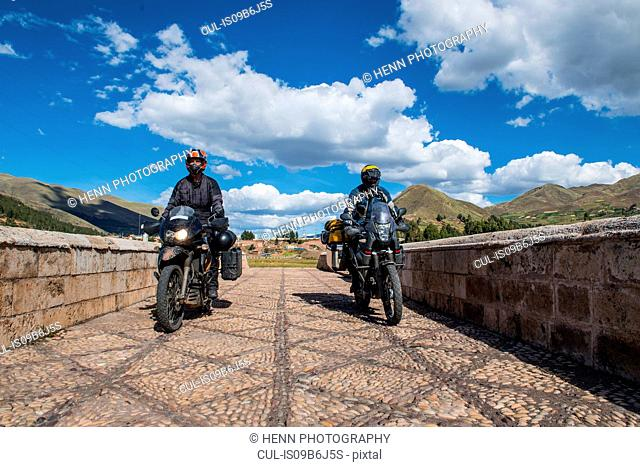 Motorbikes driving over a bridge of the Urubamba River, Chocosillane Pucara, Cusco, Peru, South America