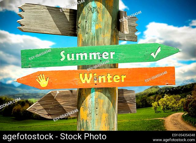 Street Sign the Direction Way to Summer versus Winter