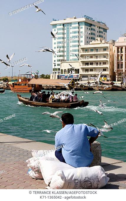 Small dow boats offer water taxi service along Dubai Creek in Dubai, UAE, Persian Gulf