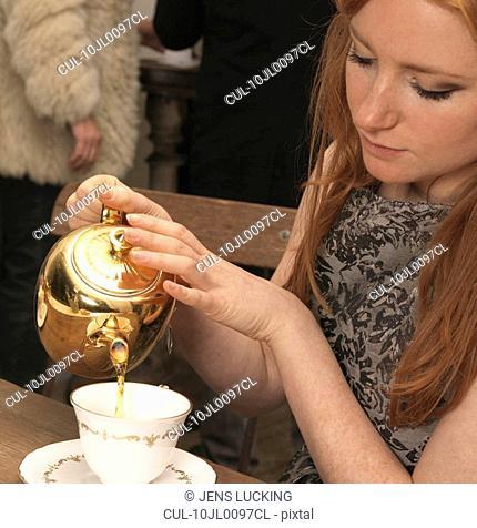 Young woman having tea in café