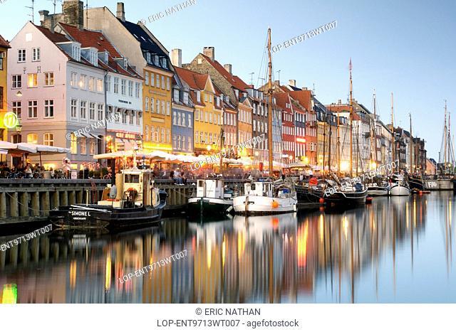 Denmark, Hovedstaden, Copenhagen. Boats and townhouses along the Nyhavn canal in Copenhagen