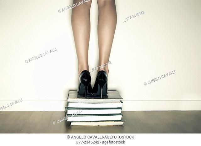 Woman ove a stack of books. New York, USA