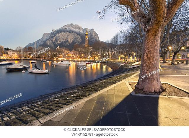 Lakefront of Lecco before dawn with San Martino mount in background, Lecco, Lecco province, Lombardy, italy