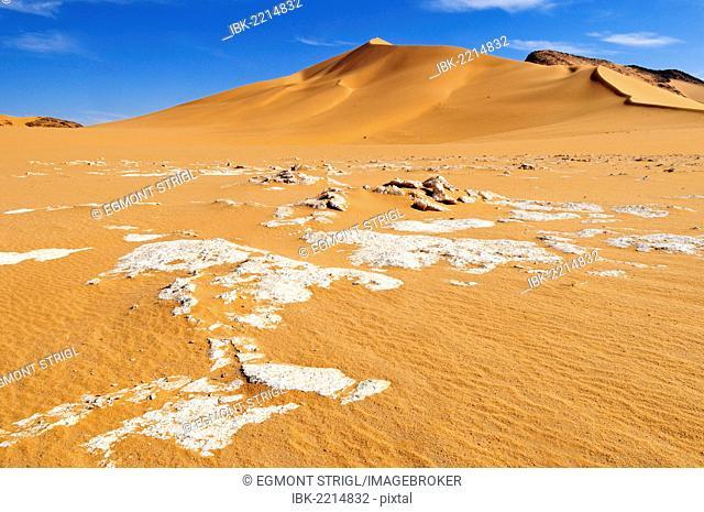 Surface of a salt and clay pan and sand dunes at Erg Mehedjibat, Immidir, Algeria, Sahara, North Africa