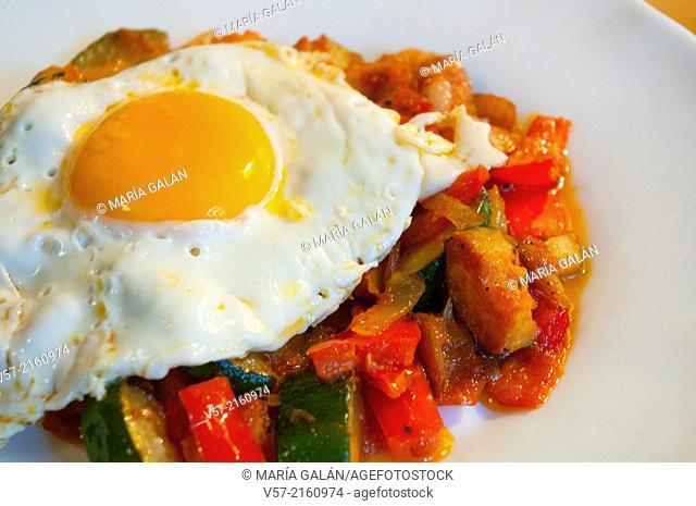 Fried egg on pisto manchego, close view. La Mancha, Spain