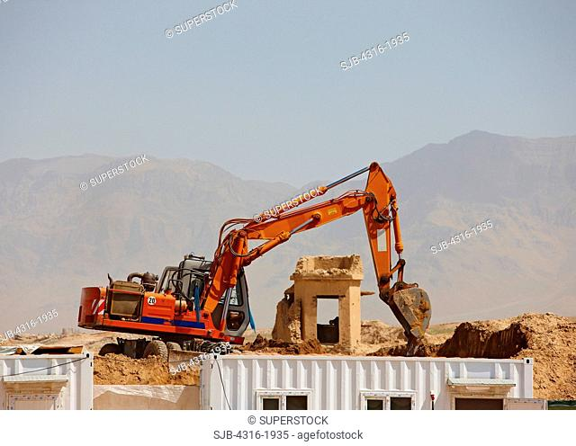 Excavator Preparing a Building Site